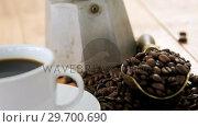 Купить «Coffee with coffeemaker and scoop», видеоролик № 29700690, снято 6 октября 2016 г. (c) Wavebreak Media / Фотобанк Лори