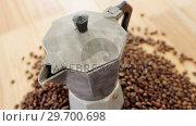 Купить «Coffee beans with metallic coffeemaker», видеоролик № 29700698, снято 6 октября 2016 г. (c) Wavebreak Media / Фотобанк Лори