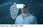 Купить «Man using virtual reality headset and futuristic screen», видеоролик № 29700790, снято 11 мая 2017 г. (c) Wavebreak Media / Фотобанк Лори