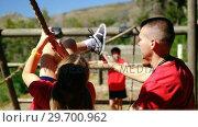 Купить «Trainer training kids in the boot camp», видеоролик № 29700962, снято 16 марта 2017 г. (c) Wavebreak Media / Фотобанк Лори