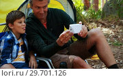 Купить «Father and son taking a selfie on mobile phone outside tent», видеоролик № 29701126, снято 2 марта 2017 г. (c) Wavebreak Media / Фотобанк Лори