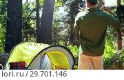 Купить «Father and son having fun outside tent», видеоролик № 29701146, снято 2 марта 2017 г. (c) Wavebreak Media / Фотобанк Лори