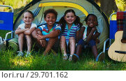 Купить «Kids sitting outside tent at campsite», видеоролик № 29701162, снято 2 марта 2017 г. (c) Wavebreak Media / Фотобанк Лори