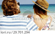 Купить «Couple enjoying together at beach», видеоролик № 29701294, снято 17 января 2017 г. (c) Wavebreak Media / Фотобанк Лори
