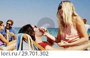 Купить «Couple enjoying together at beach», видеоролик № 29701302, снято 17 января 2017 г. (c) Wavebreak Media / Фотобанк Лори