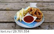 Купить «Onion ring and french fries with ketchup arranged in plate», видеоролик № 29701554, снято 13 января 2017 г. (c) Wavebreak Media / Фотобанк Лори
