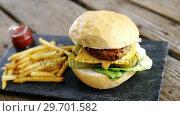 Купить «Hamburger and french fries with ketchup on slate board», видеоролик № 29701582, снято 13 января 2017 г. (c) Wavebreak Media / Фотобанк Лори