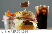 Купить «Hamburger, french fries and cold drink on table», видеоролик № 29701586, снято 13 января 2017 г. (c) Wavebreak Media / Фотобанк Лори