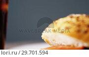 Cold drink and hamburger against grey background. Стоковое видео, агентство Wavebreak Media / Фотобанк Лори