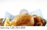 Купить «Hamburger and french fries on table», видеоролик № 29701650, снято 13 января 2017 г. (c) Wavebreak Media / Фотобанк Лори