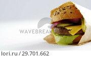 Купить «Hamburger in a take away bag on table», видеоролик № 29701662, снято 13 января 2017 г. (c) Wavebreak Media / Фотобанк Лори