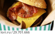 Купить «Hamburger in a take away container on table», видеоролик № 29701666, снято 13 января 2017 г. (c) Wavebreak Media / Фотобанк Лори