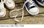 Купить «Pairs of new shoes on wooden plank», видеоролик № 29701734, снято 13 января 2017 г. (c) Wavebreak Media / Фотобанк Лори