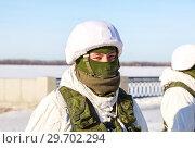 Купить «Unidentified Russian soldier in modern military winter uniform at the street during the city festival», фото № 29702294, снято 27 января 2018 г. (c) FotograFF / Фотобанк Лори