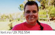 Купить «Portrait of confident woman standing in boot camp», видеоролик № 29702554, снято 16 марта 2017 г. (c) Wavebreak Media / Фотобанк Лори