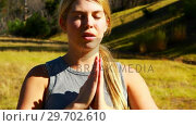 Купить «Beautiful woman practicing yoga during obstacle course», видеоролик № 29702610, снято 16 марта 2017 г. (c) Wavebreak Media / Фотобанк Лори