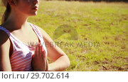Купить «Beautiful woman practicing yoga during obstacle course», видеоролик № 29702614, снято 16 марта 2017 г. (c) Wavebreak Media / Фотобанк Лори