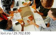 Купить «Happy executives sharing pizza in conference room at office», видеоролик № 29702830, снято 26 марта 2017 г. (c) Wavebreak Media / Фотобанк Лори