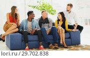 Купить «Business colleagues sitting together on a couch», видеоролик № 29702838, снято 26 марта 2017 г. (c) Wavebreak Media / Фотобанк Лори