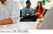 Купить «Male and female executives discussing over digital tablet in the office», видеоролик № 29702842, снято 26 марта 2017 г. (c) Wavebreak Media / Фотобанк Лори