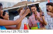 Group of friends toasting beer bottles. Стоковое видео, агентство Wavebreak Media / Фотобанк Лори