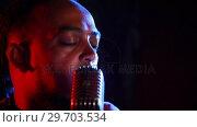 Купить «Male singer singing into a microphone 4k», видеоролик № 29703534, снято 7 марта 2017 г. (c) Wavebreak Media / Фотобанк Лори