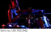 Купить «Female drummer playing on drum set 4k», видеоролик № 29703542, снято 7 марта 2017 г. (c) Wavebreak Media / Фотобанк Лори