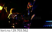 Купить «Music band performing on stage 4k», видеоролик № 29703562, снято 7 марта 2017 г. (c) Wavebreak Media / Фотобанк Лори
