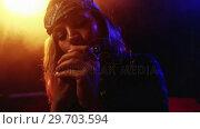 Купить «Woman playing harmonica at nightclub 4k», видеоролик № 29703594, снято 7 марта 2017 г. (c) Wavebreak Media / Фотобанк Лори