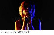 Купить «Female singer singing into a microphone 4k», видеоролик № 29703598, снято 7 марта 2017 г. (c) Wavebreak Media / Фотобанк Лори