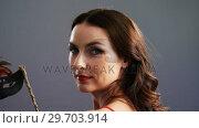Купить «Portrait of beautiful woman wearing masquerade mask 4k», видеоролик № 29703914, снято 22 мая 2017 г. (c) Wavebreak Media / Фотобанк Лори