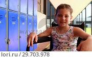 Купить «Portrait of handicapped schoolgirl sitting on wheelchair 4k», видеоролик № 29703978, снято 11 марта 2017 г. (c) Wavebreak Media / Фотобанк Лори