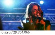 Купить «Singer performing on stage 4k», видеоролик № 29704066, снято 7 марта 2017 г. (c) Wavebreak Media / Фотобанк Лори