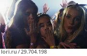 Купить «Group of women giving flying kiss at a concert 4k», видеоролик № 29704198, снято 7 марта 2017 г. (c) Wavebreak Media / Фотобанк Лори