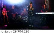 Купить «Singer performing on stage at a concert 4k», видеоролик № 29704226, снято 7 марта 2017 г. (c) Wavebreak Media / Фотобанк Лори