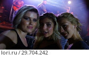 Купить «Female friends posing together at a concert 4k», видеоролик № 29704242, снято 7 марта 2017 г. (c) Wavebreak Media / Фотобанк Лори