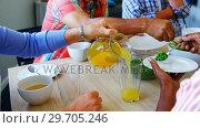 Senior friends having breakfast on dining table 4k. Стоковое видео, агентство Wavebreak Media / Фотобанк Лори