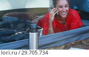 Купить «Woman taking on mobile phone 4k», видеоролик № 29705734, снято 9 марта 2017 г. (c) Wavebreak Media / Фотобанк Лори