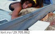 Купить «Woman sleeping in the tent 4k», видеоролик № 29705862, снято 9 марта 2017 г. (c) Wavebreak Media / Фотобанк Лори