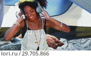 Купить «Woman listening to headphones 4k», видеоролик № 29705866, снято 9 марта 2017 г. (c) Wavebreak Media / Фотобанк Лори