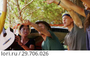 Купить «Group of friends asking for lift on road 4k», видеоролик № 29706026, снято 9 марта 2017 г. (c) Wavebreak Media / Фотобанк Лори