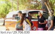 Купить «Group of friends asking for lift on road 4k», видеоролик № 29706030, снято 9 марта 2017 г. (c) Wavebreak Media / Фотобанк Лори