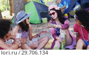 Купить «Female friends interacting with each other at music festival 4k», видеоролик № 29706134, снято 9 марта 2017 г. (c) Wavebreak Media / Фотобанк Лори