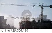 Купить «Crane and building construction site 4k», видеоролик № 29706190, снято 14 июня 2017 г. (c) Wavebreak Media / Фотобанк Лори