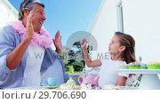 Купить «Daughter and father in fairy costume having fun 4k», видеоролик № 29706690, снято 24 марта 2017 г. (c) Wavebreak Media / Фотобанк Лори