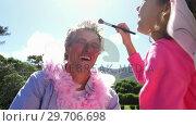Купить «Cute daughter in fairy costume putting makeup on her fathers face 4k», видеоролик № 29706698, снято 24 марта 2017 г. (c) Wavebreak Media / Фотобанк Лори