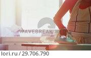 Купить «Woman ironing shirt on ironing board in kitchen 4k», видеоролик № 29706790, снято 24 марта 2017 г. (c) Wavebreak Media / Фотобанк Лори