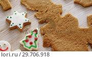 Купить «Gingerbread dough with star shapes on wooden table 4k», видеоролик № 29706918, снято 5 мая 2017 г. (c) Wavebreak Media / Фотобанк Лори