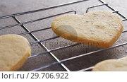 Купить «Raw heart shape cookies with sugar icing on baking tray 4k», видеоролик № 29706922, снято 5 мая 2017 г. (c) Wavebreak Media / Фотобанк Лори