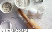 Купить «Gingerbread cookies ingredients on a table 4k», видеоролик № 29706942, снято 5 мая 2017 г. (c) Wavebreak Media / Фотобанк Лори